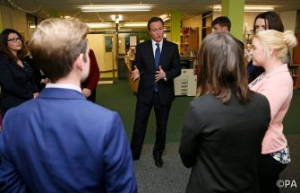 Prime Minister David Cameron speaks with trainee teachers at the Harris City Academy in south London.